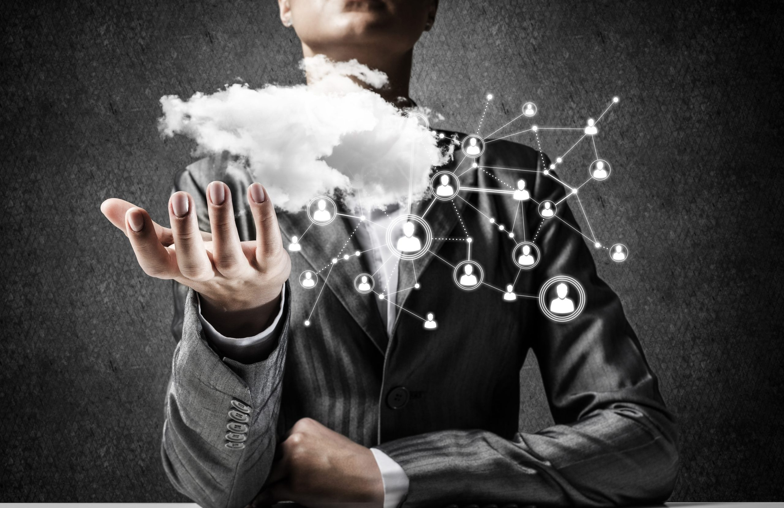 rmda-ss-businessman-suit-keeping-cloud-connections.5000.3500